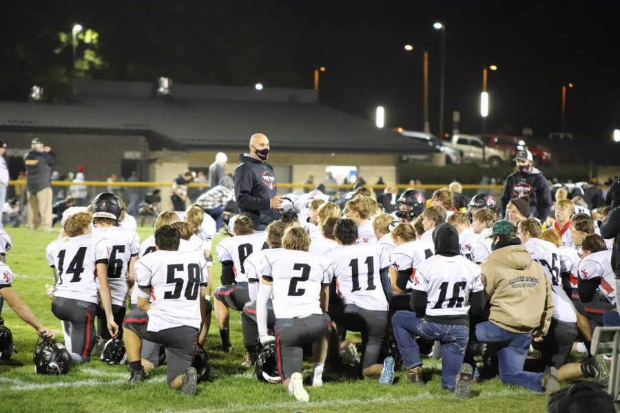 Coach TeBrinks talks to the team after the game.