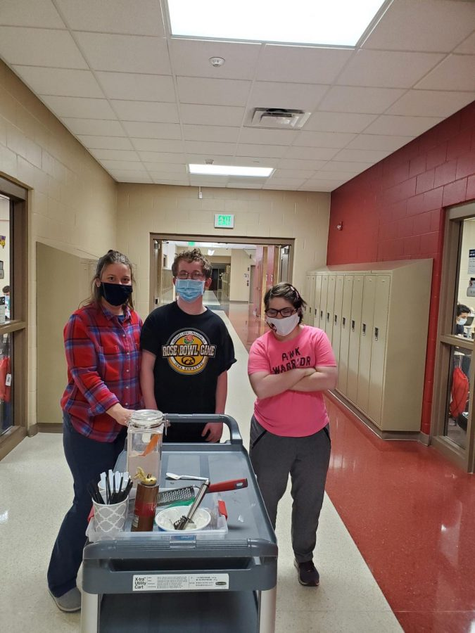 Mrs. Angela Pardun, Timmy Schiltz, and Maddie Hammond deliver morning coffee to high school teachers.