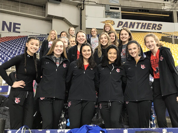 The varsity girls track team from the 2020 season that got cancelled due to COVID-19 at their one and only track meet at the University of Northern Iowa's indoor track.