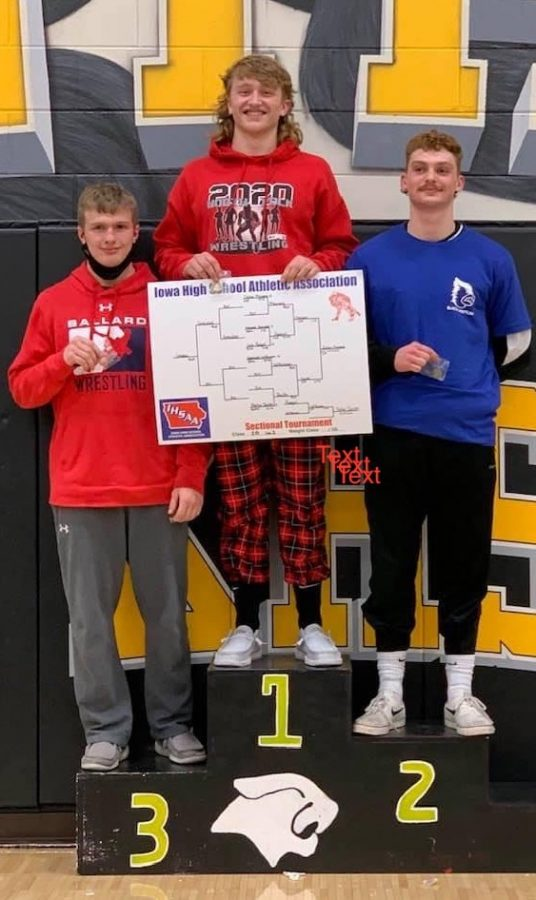Dylan Meiners holding his winning bracket on the podium next to his competitors on Feb. 7, 2021.