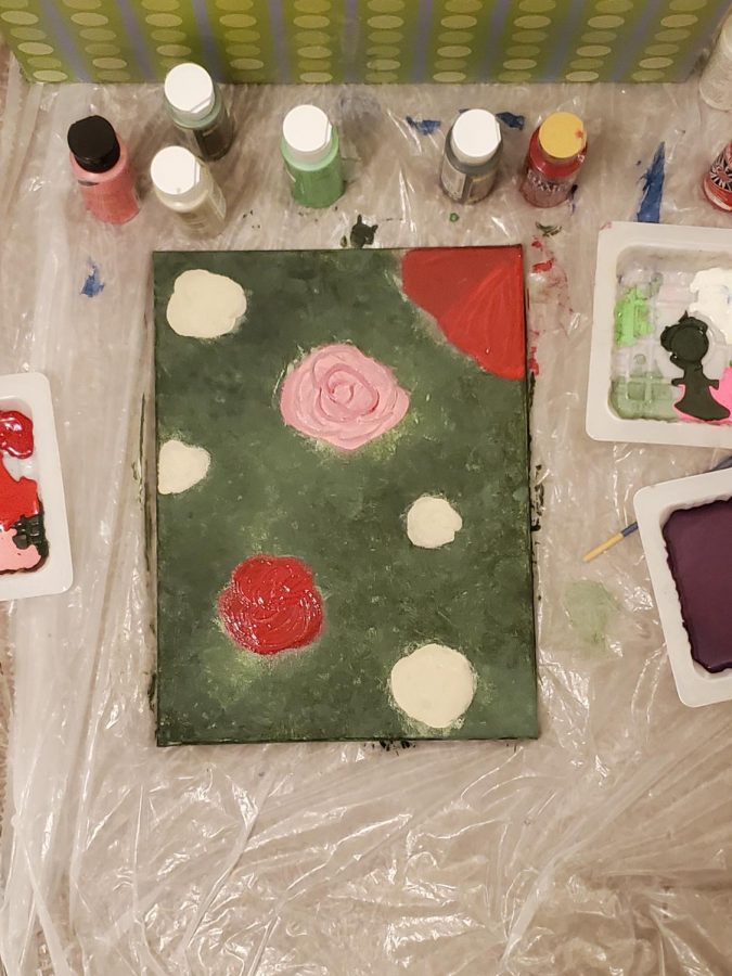 An unfinished acrylic painting of a rosebush that I started later in my quarantine.