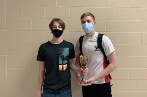 Brice Sandahl and Grant Christensen with their first place trophy from winning the Junior Stock Challenge.