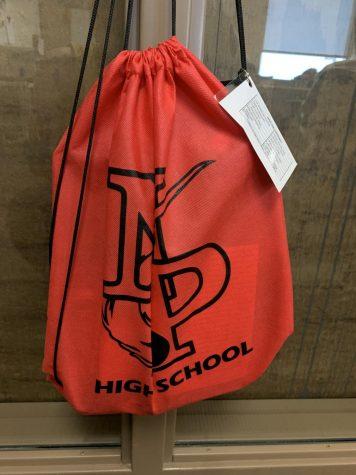 During a fire drill all teachers are required to bring the emergency bag. The bag contains bandaids, class rosters, and the emergency cards.