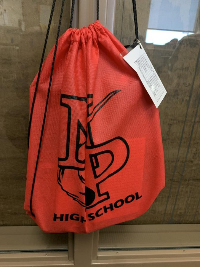 During+a+fire+drill+all+teachers+are+required+to+bring+the+emergency+bag.+The+bag+contains+bandaids%2C+class+rosters%2C+and+the+emergency+cards.